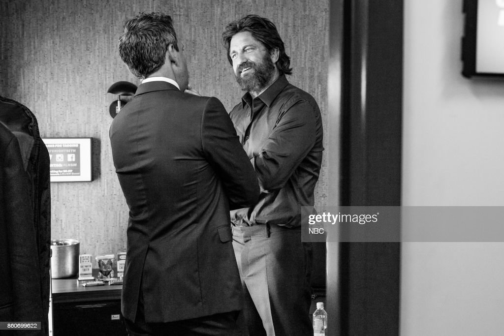 MEYERS -- (EXCLUSIVE COVERAGE) -- Episode 594 -- Pictured: (l-r) Host Seth Meyers talks with actor Gerard Butler backstage on October 12, 2017 --