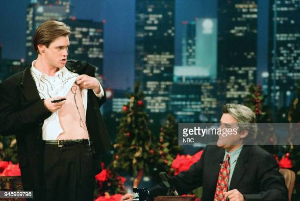 Actor Jim Carrey draws on himself during an interview with host Jay Leno on