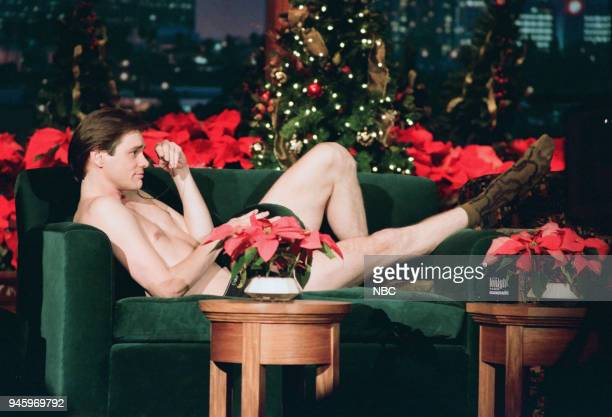 Actor Jim Carrey strips during an interview on