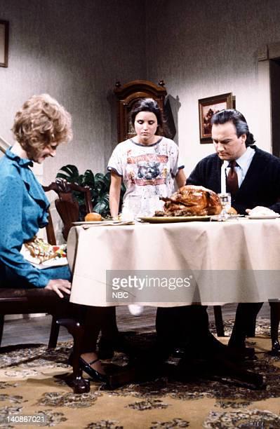 Mary Gross as Frances Julia LouisDreyfus as Katie Jim Belushi as Jim during the 'Thanksgiving Dinner' skit on November 19 1983