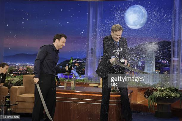 BRIEN Episode 60 Air Date Pictured Actress Jennifer Connelly Three Shees host Zane Lamprey host Conan O'Brien saber a bottle of champagne on...