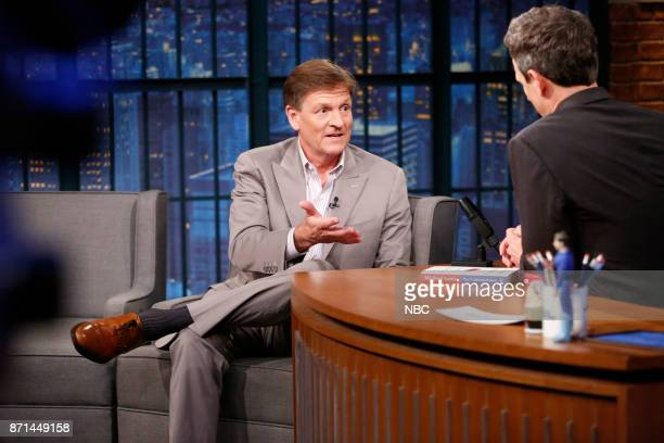 Author Michael Lewis talks with host Seth Meyers during an interview on November 7 2017