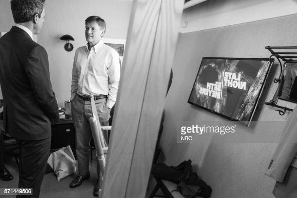 MEYERS Episode 604 Pictured Host Seth Meyers talks with author Michael Lewis backstage on November 7 2017