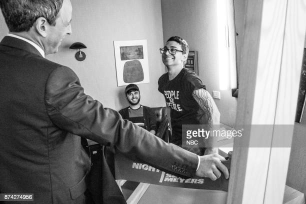 MEYERS Episode 608 Pictured Host Seth Meyers talks with designer Christian Siriano backstage on November 14 2017
