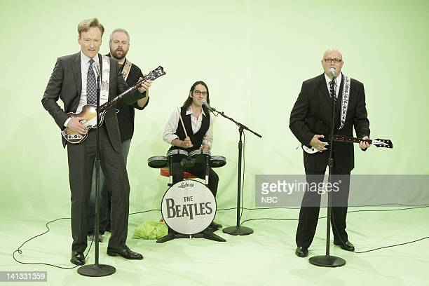 Episode 61 -- Air Date -- Pictured: Host Conan O'Brien, Dhani Harrison, and Tonight Show band member Mark Pender play the new Beatles Rockband video...