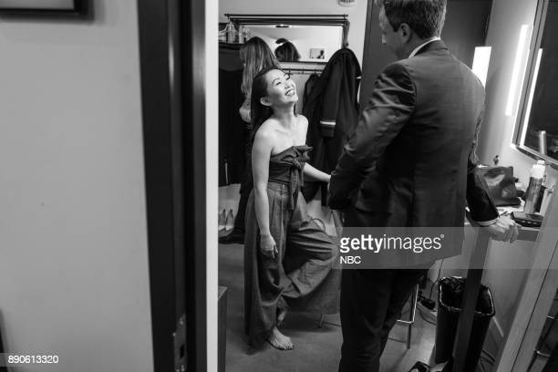 MEYERS Episode 623 Pictured Actress Hong Chau talks with host Seth Meyers backstage on December 11 2017