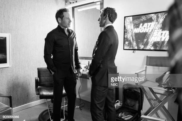 MEYERS Episode 634 Pictured Actor David Duchovny talks with host Seth Meyers backstage on January 15 2018