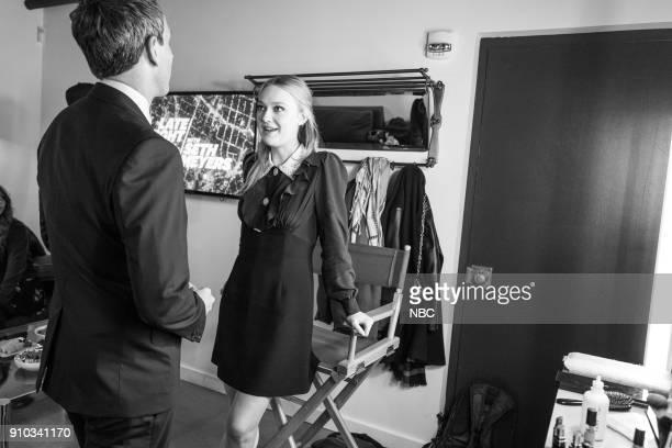 MEYERS Episode 641 Pictured Host Seth Meyers talks with actor Dakota Fanning backstage on January 25 2018