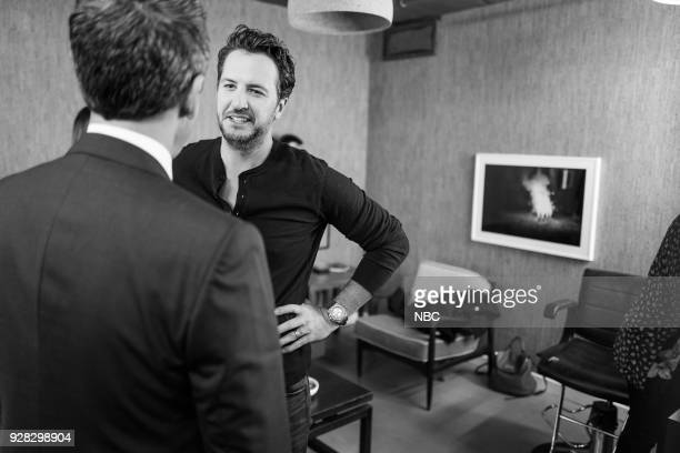 MEYERS Episode 655 Pictured Host Seth Meyers talks with musical guest Luke Bryan backstage on March 6 2018