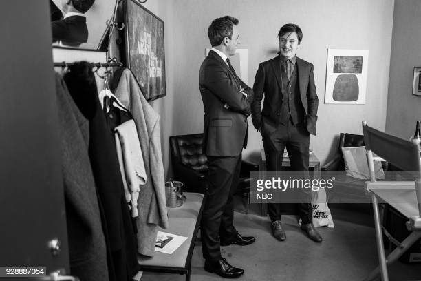 MEYERS Episode 656 Pictured Host Seth Meyers talks with actor Nick Robinson backstage on March 7 2018