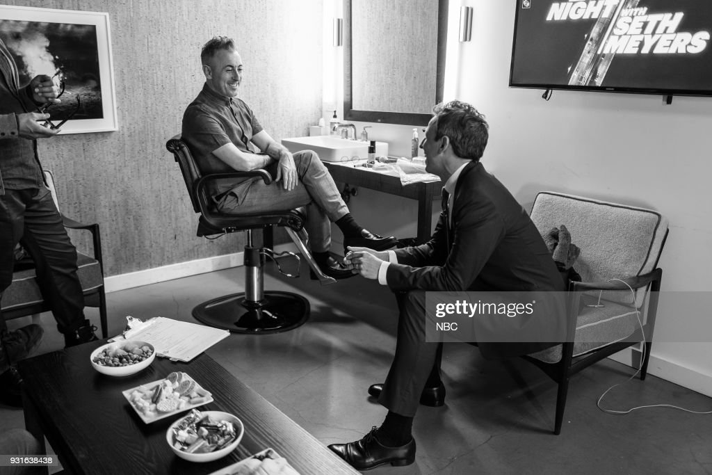 MEYERS -- (EXCLUSIVE COVERAGE) -- Episode 659 -- Pictured: (l-r) Actor Alan Cumming talks with host Seth Meyers backstage on March 13, 2018 --
