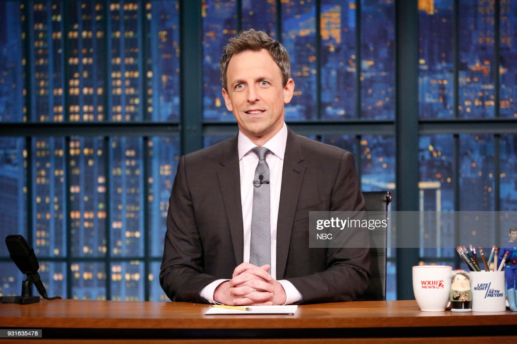 Host Seth Meyers at his desk during the monologue on March 13, 2018 --
