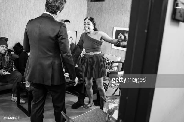 MEYERS Episode 670 Pictured Host Seth Meyers talks with actress Tiffany Haddish backstage on April 9 2018