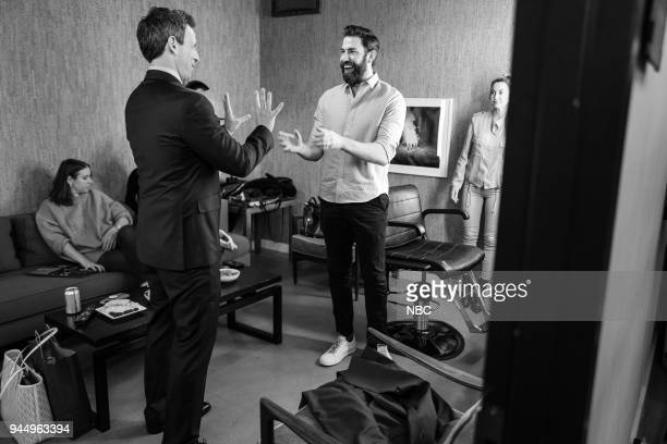 MEYERS Episode 672 Pictured Host Seth Meyers talks with actor John Krasinski backstage on April 11 2018