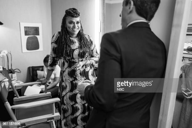 MEYERS Episode 690 Pictured Director Ava DuVernay talks with host Seth Meyers backstage on May 21 2018