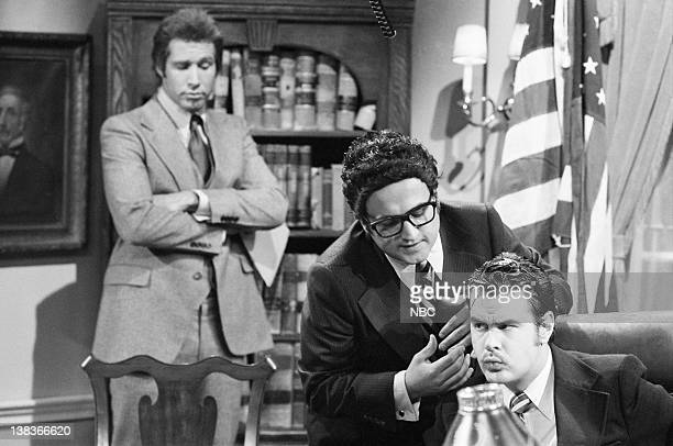 Chevy Chase John Belushi as Henry Kissinger Dan Aykroyd as Richard Nixon during the 'Blonde Ambition' skit on November 13 1976