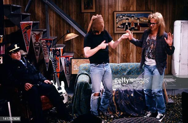 John Goodman as Mark Wilson Mike Myers as Wayne Campbell Dana Carvey as Garth Algar during the 'Wayne's World' skit on December 2 1989