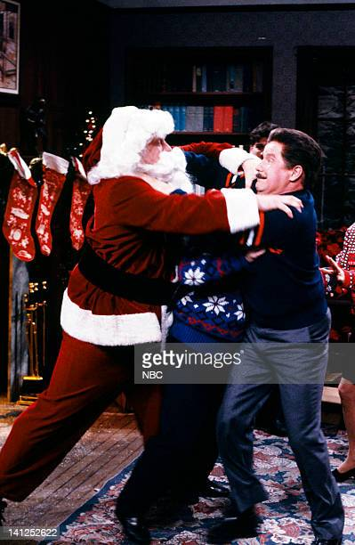 John Goodman as Santa Claus Phil Hartman as Mike Ditka during the 'The Mike Ditka TypeA Christmas Special' skit on December 2 1989