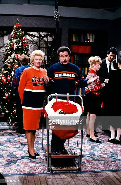 Phil Hartman as Mike Ditka Nora Dunn as Cookie Ditka during the 'The Mike Ditka TypeA Christmas Special' skit on December 2 1989