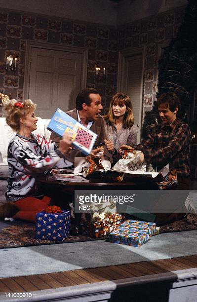 Victoria Jackson as Daughter Phil Hartman as Father Jan Hooks as Mother Dana Carvey as Son during the 'AlAnon' skit on December 13 1986 Photo by Alan...
