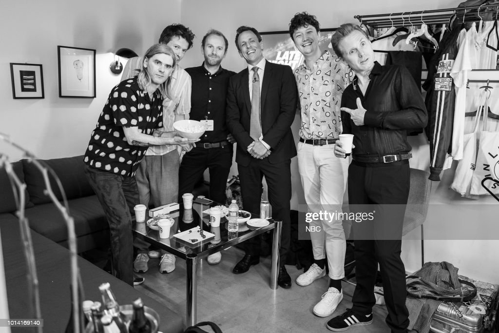 MEYERS -- (EXCLUSIVE COVERAGE) -- Episode 721 -- Pictured: (l-r) Paul Thomson, Donald Barr, Robert Hardy, Julian Corrie and Alexander Huntley of musical guest Franz Ferdinand with host Seth Meyers (center) backstage on August 9, 2018 --