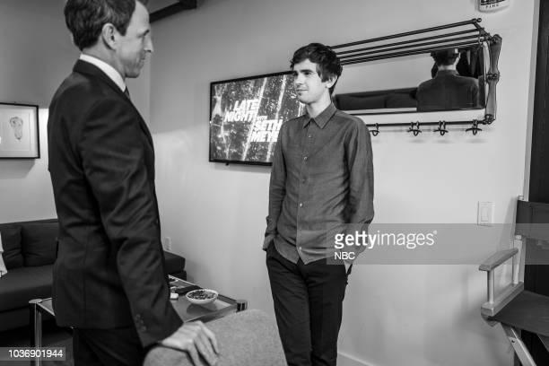 MEYERS Episode 736 Pictured Host Seth Meyers talks with actor Freddie Highmore backstage on September 20 2018