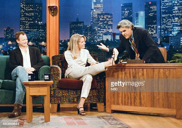 Actor Gary Sinise and actress Bridgette Wilson during an interview with host Jay Leno on September 4 1995