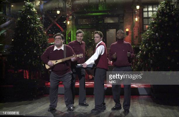 LIVE Episode 8 Air Date Pictured Horatio Sanz Jimmy Fallon Chris Kattan Tracy Morgan during the 'Season's Greeting' skit on January 9 2000 Photo by...
