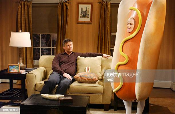 LIVE Episode 8 Aired Pictured Alec Baldwin as Jeremy Connors Amy Poehler as daughter during 'Hot Dog Family' skit on December 10 2005