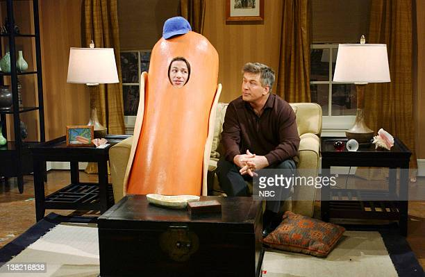 LIVE Episode 8 Aired Pictured Andy Samberg as son Oscar Alec Baldwin as Jeremy Connors during 'Hot Dog Family' skit on December 10 2005