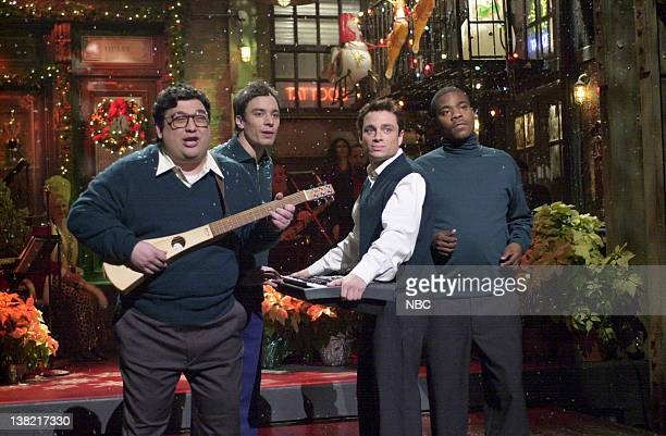 LIVE Episode 8 Aired Pictured Horatio Sanz Jimmy Fallon Chris Kattan Tracy Morgan during 'Season's Greetings' skit on December 16 2000