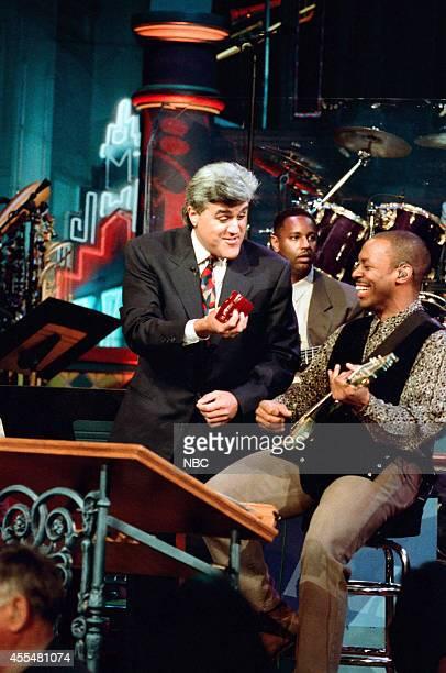 Host Jay Leno and The Tonight Show Band's leader Kevin Eubanks on November 21 1995