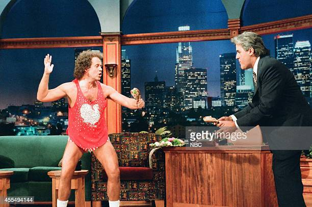 Fitness personality Richard Simmons and Jay Leno during a turkey leg fight on November 22 1995