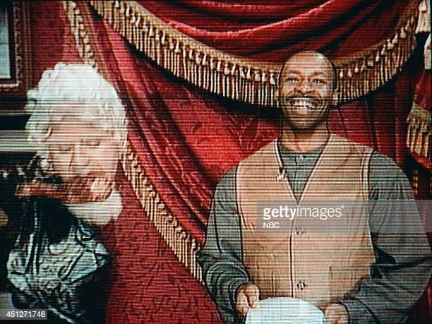 Host Jay Leno and The Tonight Show Band's leader Kevin Eubanks are seen on screen during the Beyondo sketch on November 24 1995