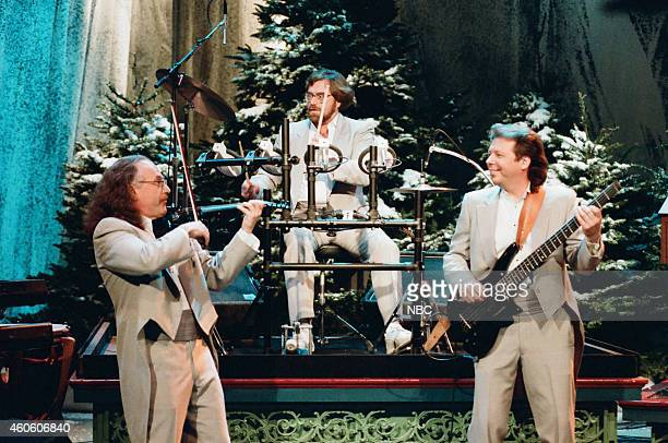 Arnie Roth Chip Davis and Ron Cooley of the musical group Mannheim Steamroller perform on December 18 1995