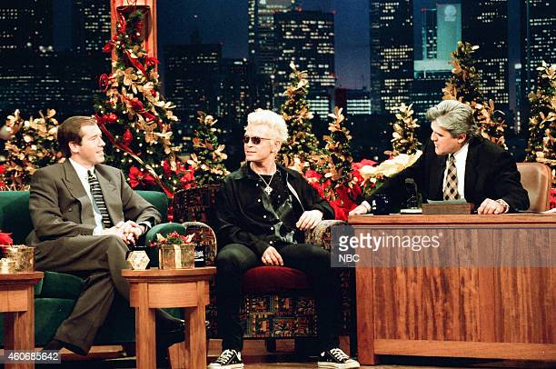 News anchor Brian Williams and musical guest Billy Idol during an interview with host Jay Leno on December 19 1995