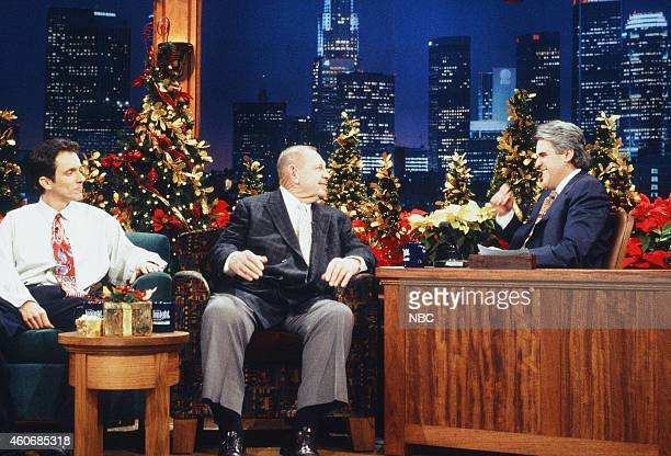 Comedian Jake Johannsen and former professional football player Art Donovan during an interview with host Jay Leno on December 20 1995