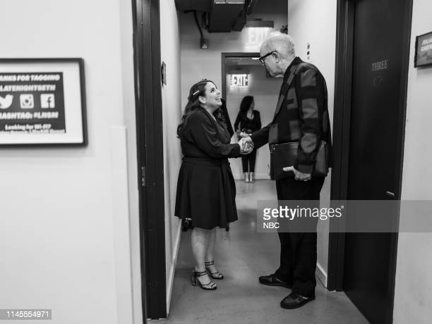 Episode 843 -- Pictured: Actress Beanie Feldstein talks with actor John Lithgow backstage on May 22, 2019 --