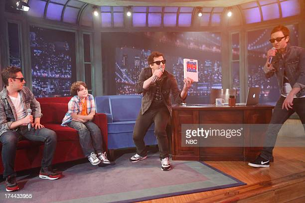 """Episode 871 -- Pictured: """"The Lonely Islands"""" Jorma Taccone, Luke Fava, Andy Samberg and Akiva Schaffer during a performance of """"YOLO"""" on July 25,..."""
