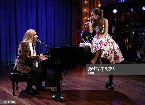 Episode 886 -- Pictured: Jimmy Fallon and Ariana Grande sing Broadway versions of rap songs on September 06, 2013 --