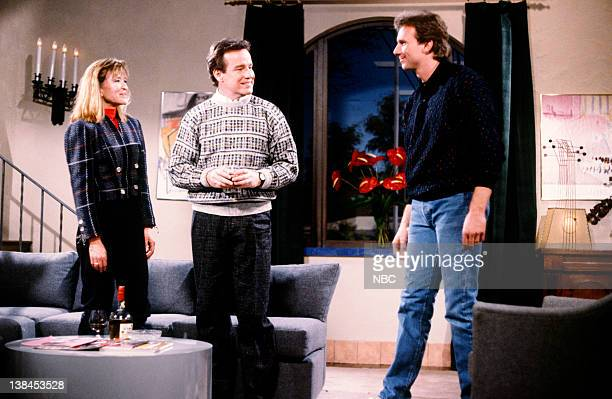 LIVE Episode 9 Aired Pictured Jan Hooks as Leslie Phil Hartman as Dan and Joe Montana as Stu during The Honest Man skit on January 24 1987