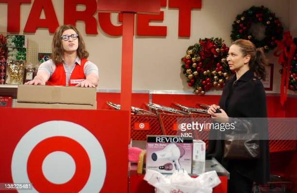 LIVE Episode 9 Aired Pictured Justin Timberlake as Marcus Maya Rudolph as customer during Target skit on December 16 2006