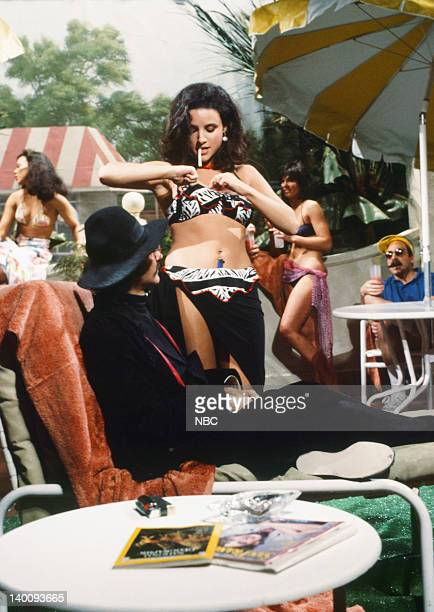 Father Guido Sarducci Julia LouisDreyfus as woman during 'The Man Who Loved Swimmin'' skit on January 14 1984
