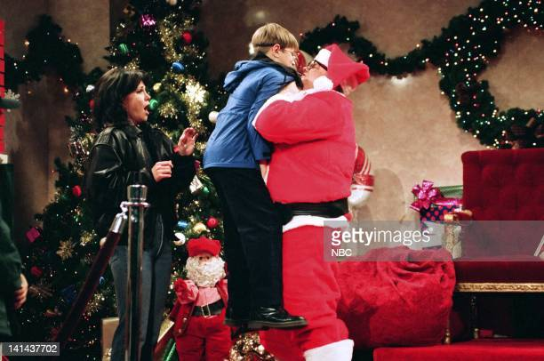 Sally Field as parent Chris Farley as Matt Foley during the 'Motivational Santa' skit on December 11 1993 Photo by Gene Page/NBC/NBCU Photo Bank