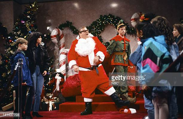 Sally Field as parent Chris Farley as Matt Foley David Spade as elf during the 'Motivational Santa' skit on December 11 1993 Photo by Gene...