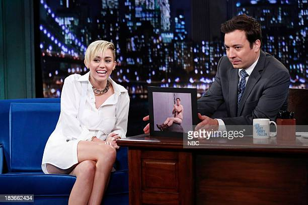 Episode 907 -- Pictured: Miley Cyrus with host Jimmy Fallon during an interview on Tuesday, October 8, 2013--