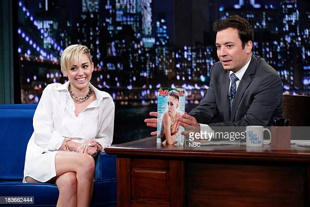 Miley Cyrus with host Jimmy Fallon during an interview on Tuesday October 8 2013