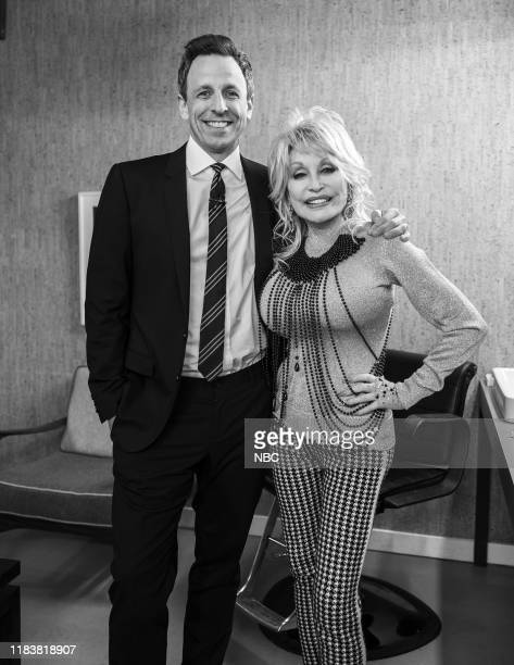 MEYERS Episode 918 Pictured Host Seth Meyers and singer Dolly Parton backstage on November 21 2019