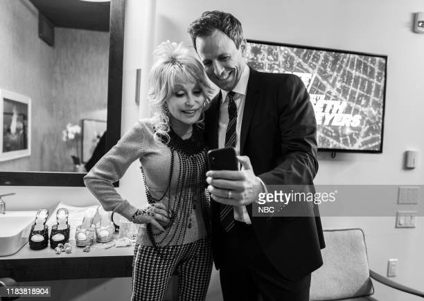 MEYERS Episode 918 Pictured Singer Dolly Parton and host Seth Meyers backstage on November 21 2019