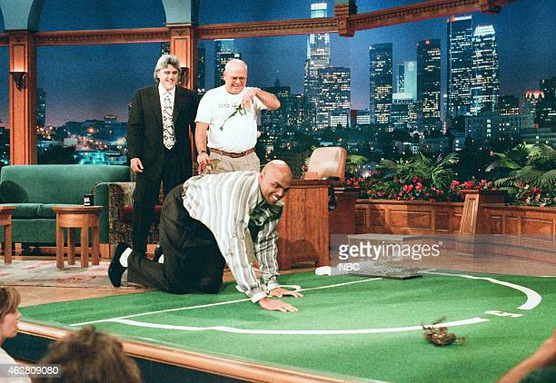 Host Jay Leno Brian Cummings and professional basketball player Charles Barkley during a frog race on May 23 1996